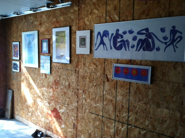 Art prints hanging on an unfinished wall